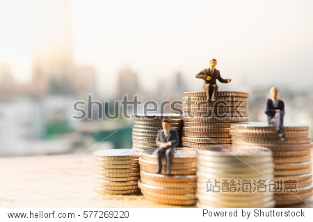 Miniature people: Small businessmen sitting on stack of coins, Money, Financial, Business Growth concept.