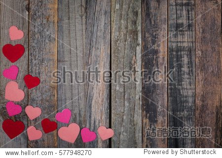Valentine's Day wooden background with abstract heart pattern. Flat lay  top view.