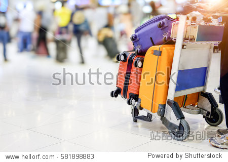 Muti colours suitcase with Trolley in airport terminal.