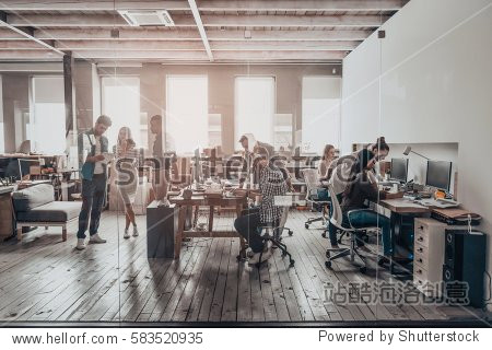 Office life. Group of young business people in smart casual wear working together in creative office
