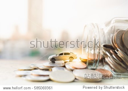 Miniature car model and Financial statement with coins. Finance and car loan  saving money for a car or material design  concepts.