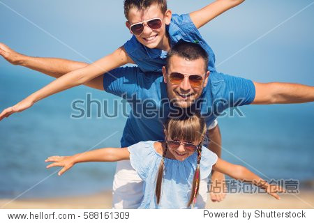 Father with children having fun.  Summer  family  vacation concept