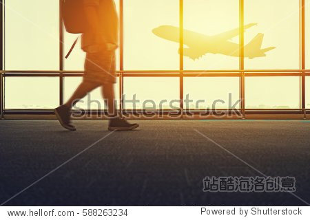 travel trip in airport concept  Motion of Business man at international airports moving to terminal gate for airplane - aerospace industry flight connections selective focus vintage tone color