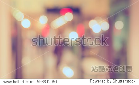 Abstract blur image of food stall at indoor day market for background usage. (vintage tone)