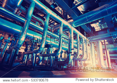 Equipment  cables and piping as found inside of a modern industrial power plant