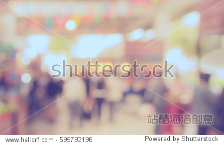 Abstract blur image of retail shop at indoor day market for background usage. (vintage tone)