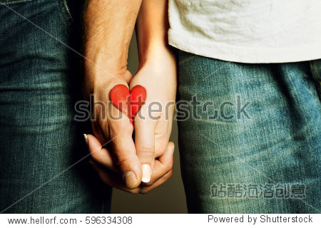 red heart drawing on hands of a couple holding hand in hand  lovers  symbol of love  togetherness  hands holding  love  valentine