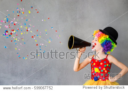 Let's party! Funny kid clown. Child speaking with megaphone. 1 April Fool's day concept
