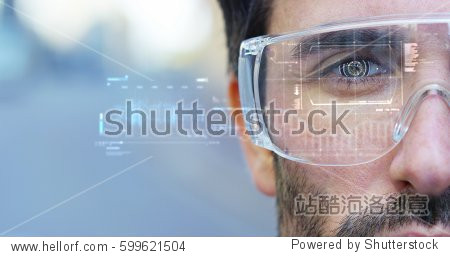 A man watches with a futuristic look with glasses augmented reality in holography. Concept: immersive technology  future  eyes  and futuristic vision.