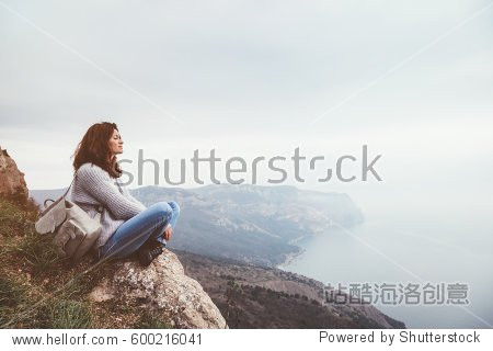 Girl travel in mountains alone. Spring weather  calm scene. Backpacker walking outdoors  back view over landscape. Wanderlust photo series.