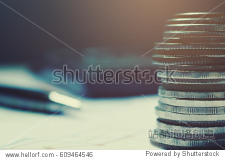 Coin on paperwork and calculator with pen background. summary report and financial analyzing concept.