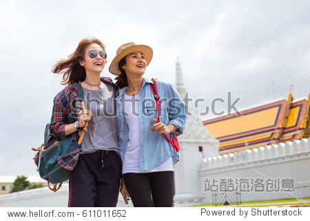Two girlfriends traveling to Grand- Palace in Bangkok Thailand