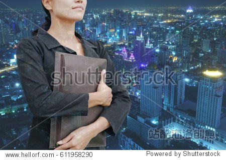 Double exposure young Business woman holding bag with Landscape of city at Night