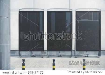 Three empty black banners with street reflections placed outside next to each other. Commerce concept. Mock up  3D Rendering