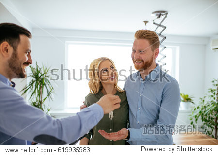 Photo of a young couple buying a new  house.