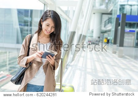 Woman checking on cellphone at Hong Kong airport