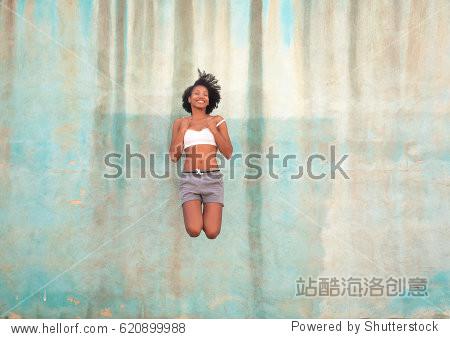 Beautiful woman jumping high
