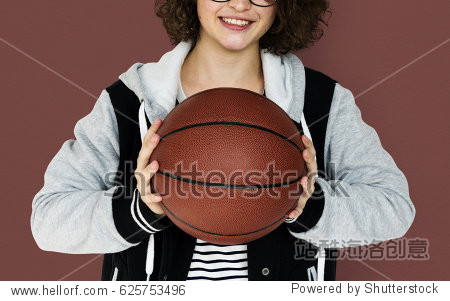 Young Adult Woman with Basketball Studio Portrait