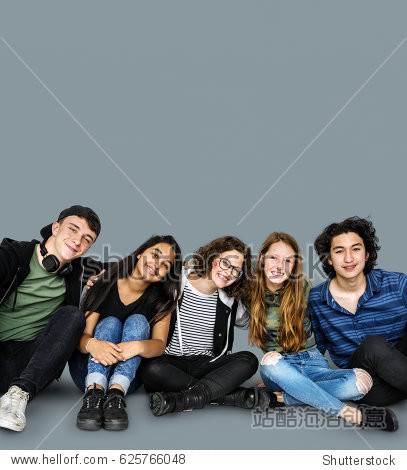Group of students smiling and huddle together