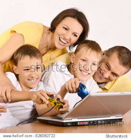 Happy parents with children  at home