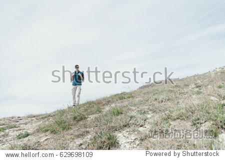 Explorer young man with backpack walking outdoor.