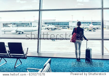 Travel business woman standing with luggage at airport