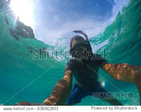 asian man take photograph under sea water