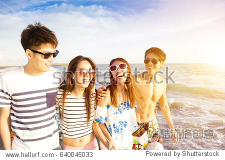 happy young group walking on the beach at summer vacation