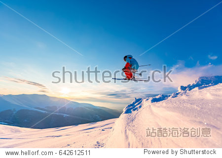 Good skiing in the snowy mountains  Carpathians  Ukraine. Beautiful winter sunset  incredible ski jump.