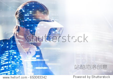 Close up image of man in virtual reality glasses. Guy wearing VR headset working in digital simulation  entertains in cyberspace. Looking on augmented reality double exposure concept with copy space