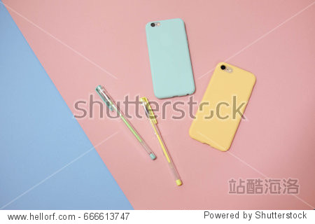 Creative flat lay photo of stationery pastel color pen and pastel smartphone on colorful pastel color