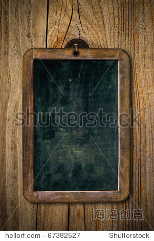 dirty and scratched wooden school slate over a wood wall  vertical image