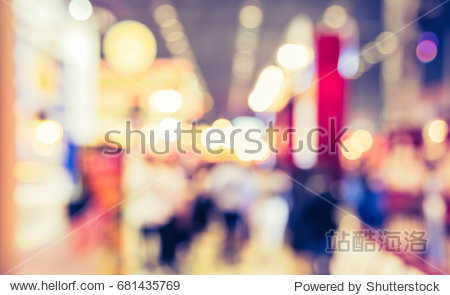 Abstract blur image of Shopping mall or Exhibition hall  with bokeh for background usage . (vintage tone)