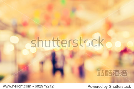 Abstract blur image of Food stall at day market with bokeh for background usage . (vintage tone)