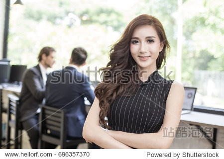 Beautiful Asian Woman Stand Front of People Work at office. Smiling Beautiful Woman with Leader Concept.