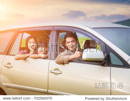 Asian family Happy in the car.Family vacation  car trip on summer  happy parents travel with kids and having fun  car insurance concept