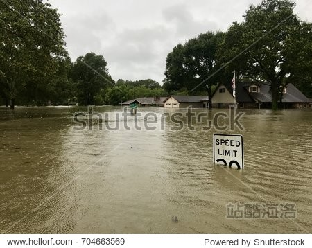 Hurricane Harvey 2017  flooding in Spring Texas  a couple miles north of Houston. Speed limit sign almost completely submerged.