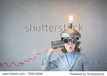 Portrait of child in classroom. Child with toy virtual reality headset in class. Funny kid with light bulb. Communication  idea and innovation technology concept. Back to school