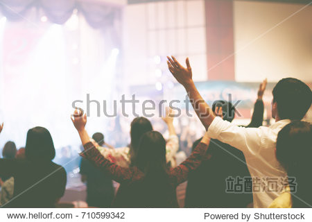 Christian worship with raised hand music concert