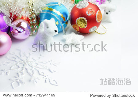 Merry Christmas and happy New Year. Light colorful background with a set of colored multi-colored Christmas toys  dog and snowflakes. Greeting card template for Christmas greetings.