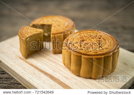 Moon cake for the chinese Mid-Autumn festival on wooden table top and wooden background