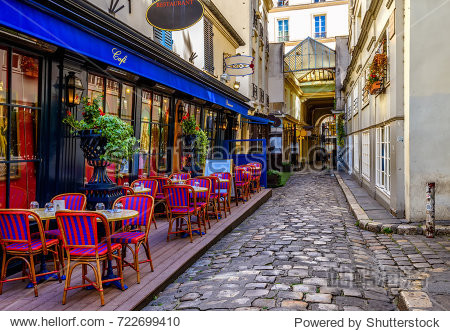Typical view of the Parisian street with tables with tables of cafe in Paris  France. Architecture and landmark of Paris. Cozy Paris cityscape
