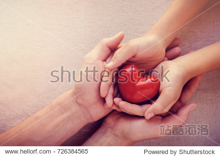 adult and child hands holding red heart  health care love  give  hope and family concept  world heart day world health day
