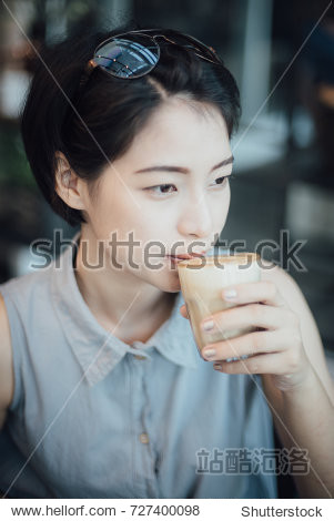 Asian woman drinking coffee cafe in vintage color tone