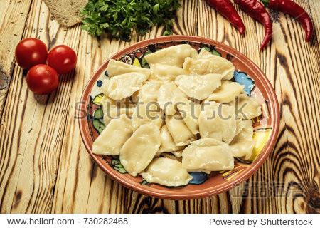 Vareniki (dumplings)  pierogi - traditional homemade Ukrainian food filled with potato and served with salty caramelized onion