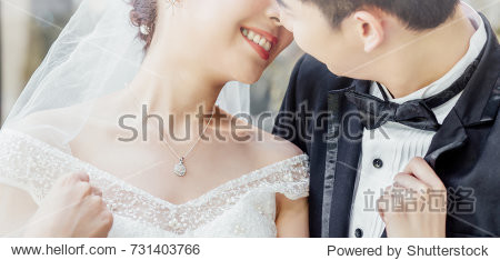 Asian groom and Asian bride are close together and are about to kiss each other with a smiling and happy face.