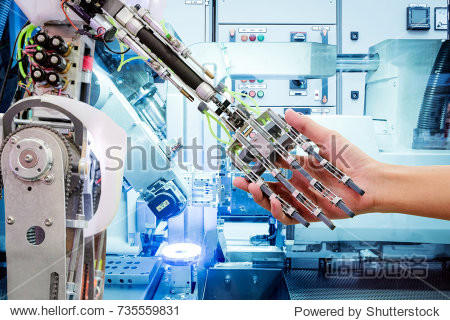 Artificial Intelligence handshake with humans on industrial robotics in blue tone color background  The robot has a role to work replacing humans in modern industries  industry 4.0 concept