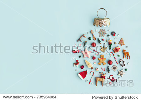 Christmas objects laid out in the shape of a Christmas bauble  overhead view