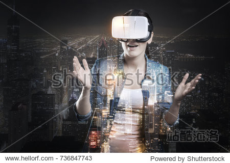 Pleasant woman playing VR game and being scared