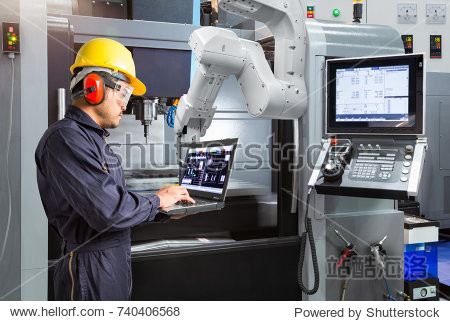 Maintenance engineer using laptop computer control automatic robotic hand with CNC machine in smart factory  Industry 4.0 concept